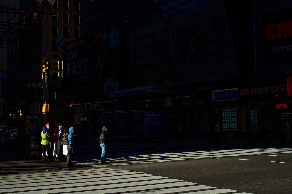 People waiting to cross 42nd Street on a Saturday morning