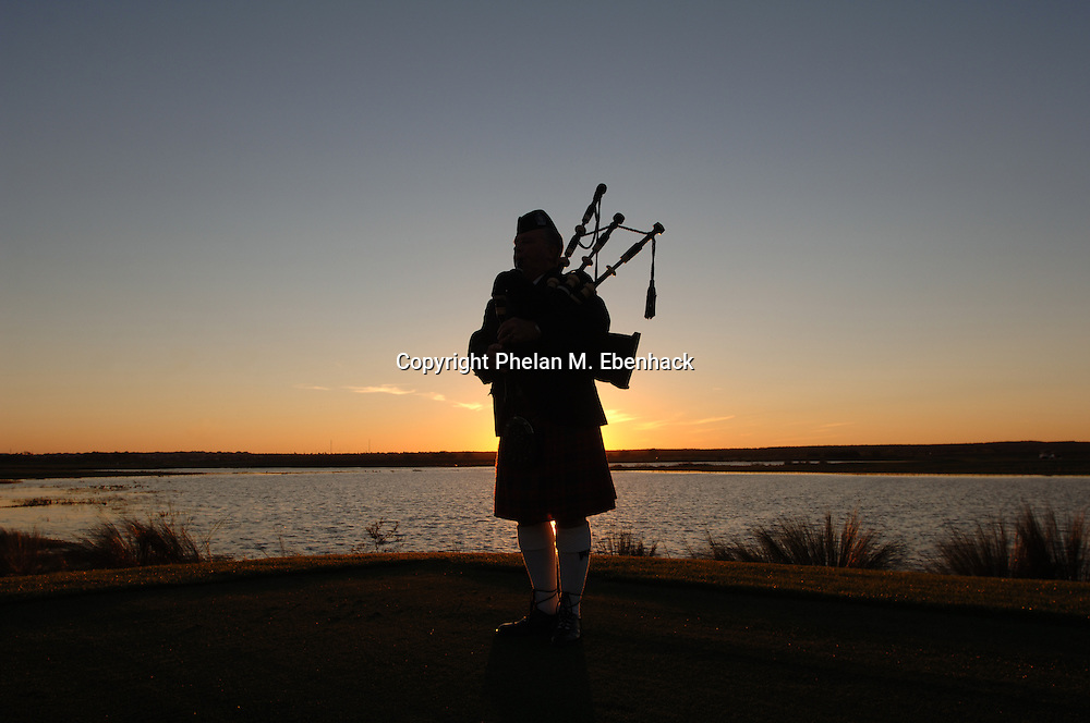 A Scottish musician plays a bagpipe at sunset at the ChampionsGate golf course outside Orlando, Florida.