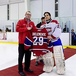 KINGSTON, ON - FEB 23,  2017: Ontario Junior Hockey League game between   Aurora Tigers and Kingston Voyageurs, Allan Etmanski presents Boyd DiClemente #29 of the Kingston Voyageurs a special game jersey marking his last regular season game in the OJHL during a special pregame ceremony.<br /> (Photo by Ian Dixon/ OJHL Images)