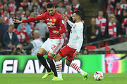 Chris Smalling Defender of Manchester United battles with Southampton Midfielder Sofiane Boufal during the EFL Cup Final between Manchester United and Southampton at Wembley Stadium, London, England on 26 February 2017. Photo by Phil Duncan.