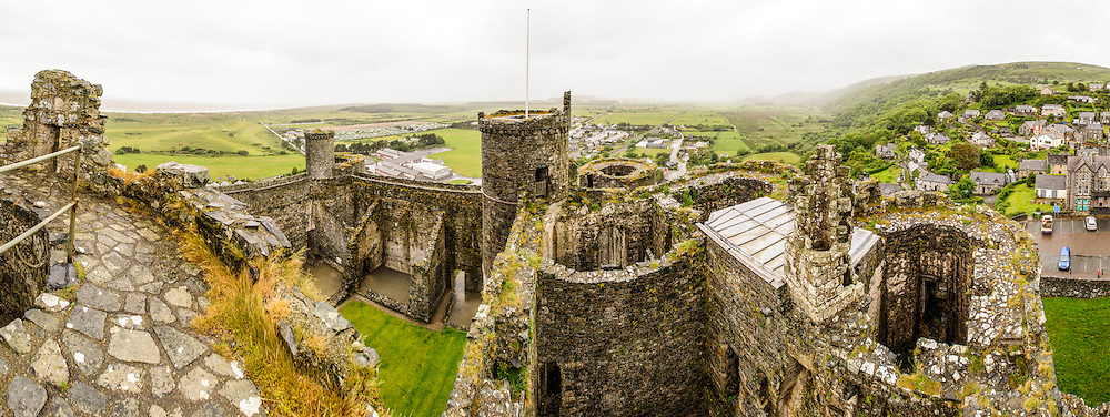 North-facing panorama of towers at Harlech Castle in Harlech, Gwynedd, on the northwest coast of Wales next to the Irish Sea. The castle was built by Edward I in the closing decades of the 13th century as one of several castles designed to consolidate his conquest of Wales.