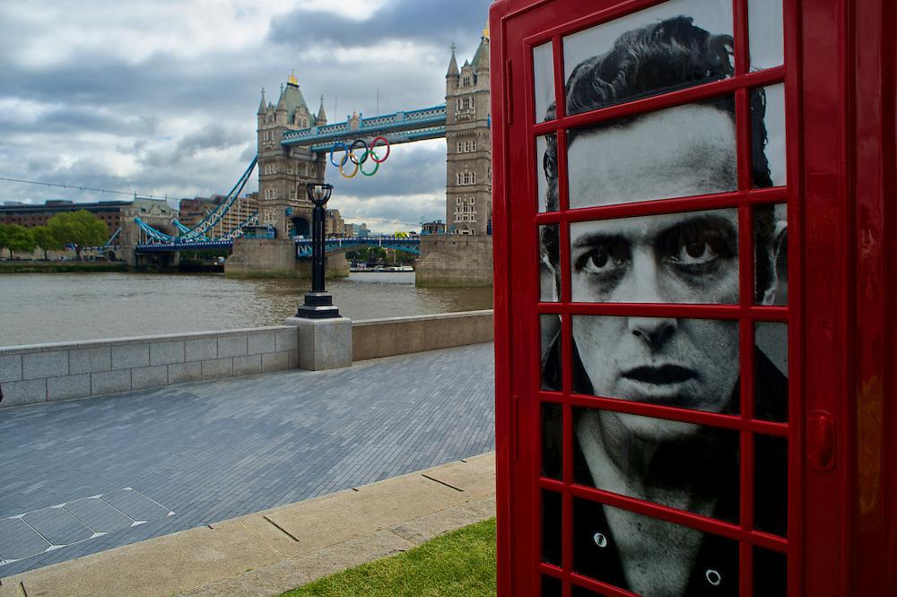 London Bridge with phone booth photo of Joe Strummer. 2012 London Olympics