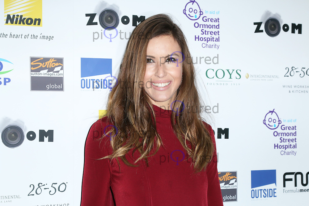 Charlie Webster, Zoom Formula 1 Charity Photographic Auction, InterContinental London, London UK, 07 February 2014, Photo by Richard Goldschmidt