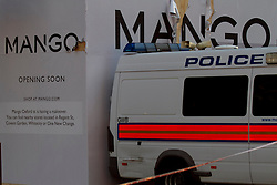 © Licensed to London News Pictures. 07/03/2012. London, UK. Police vans being used to hold up the temporary wooden hoarding of Mango on Oxford Street after it collapsed earlier, injuring three people- A man (Approx 60), and two women (approx 30 and 40) A police officer on the scene said the shop front collapsed because builders renovating shop placed heavy steel poles on the wooden facade, causing it to collapse. the  . : James Gourley/LNP