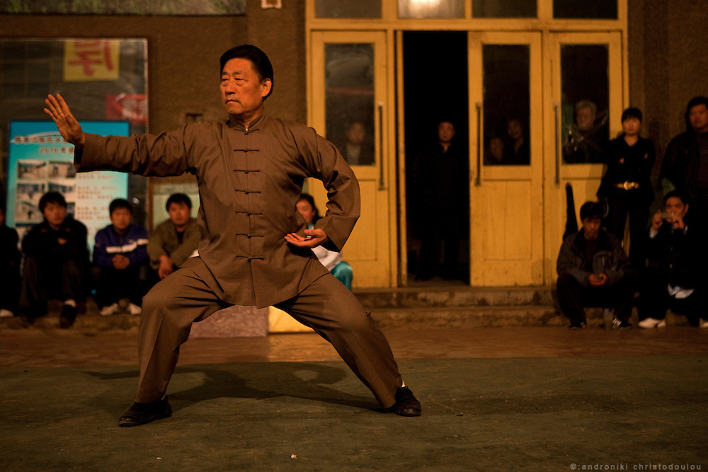 """Grandmaster Chen Xiaowang during a demonstration at the Chenjiagou Taijiquan School. Grandmaster Chen Xiaowang is a world famous Chinese Taijiquan teacher, who was born and rased in Chenjiagou. Since 1990 he left China and started promoting Taiji around the world. He is recognized as one of four """"Buddha's Warrior Attendants,"""" the four outstanding exponents of the 19th generation in Chenjiagou."""