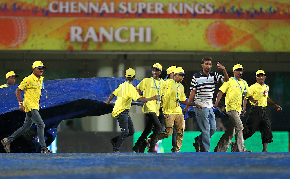 Groundsmen pull covers towards the pitch as heavy rain falls during match 21 of the Pepsi Indian Premier League Season 2014 between the Chennai Superkings and the Kolkata Knight Riders  held at the JSCA International Cricket Stadium, Ranch, India on the 2nd May  2014<br /> <br /> Photo by Deepak Malik / IPL / SPORTZPICS<br /> <br /> <br /> <br /> Image use subject to terms and conditions which can be found here:  http://sportzpics.photoshelter.com/gallery/Pepsi-IPL-Image-terms-and-conditions/G00004VW1IVJ.gB0/C0000TScjhBM6ikg