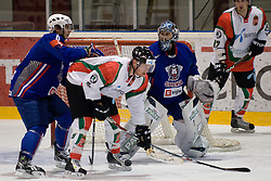 Robert Kristan (#33) and Blaz Gregorc (#6) of Slovenia vs Andras Benk of Hungary (#9) during ice-hockey match between Hungary and Slovenia in European Ice Hockey Challenge, on December 16, 2010 at Podmezaklja hall, Ljubljana, Slovenia. (Photo By Matic Klansek Velej / Sportida.com)