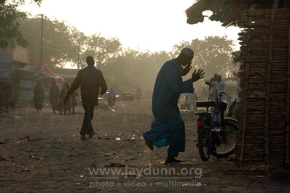 Burkina Faso, Dori, 2007. Near the Dori market, a Muslim man expresses himself in dance.