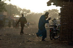 Burkina Faso, Dori, 2007. Near the Dori market, a Muslim man expresses himself in dance.