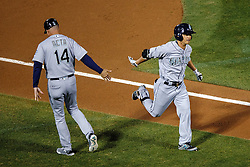 OAKLAND, CA - SEPTEMBER 09:  Norichika Aoki #8 of the Seattle Mariners is congratulated by third base coach Manny Acta #14 after hitting a home run against the Oakland Athletics during the third inning at the Oakland Coliseum on September 9, 2016 in Oakland, California. The Seattle Mariners defeated the Oakland Athletics 3-2. (Photo by Jason O. Watson/Getty Images) *** Local Caption *** Norichika Aoki; Manny Acta