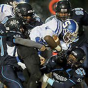 Scotland's Dajuan Monley is tackled by Hoggard defenders Friday November 28, 2014 at Hoggard High School in Wilmington, N.C. (Jason A. Frizzelle)