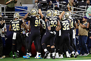 New Orleans Saints cornerback Marshon Lattimore (23) celebrates in the end zone with Saints teammates after Lattimore recovers a second quarter fumble during the NFL week 13 regular season football game against the Dallas Cowboys on Thursday, Nov. 29, 2018 in Arlington, Tex. The Cowboys won the game 13-10. (©Paul Anthony Spinelli)