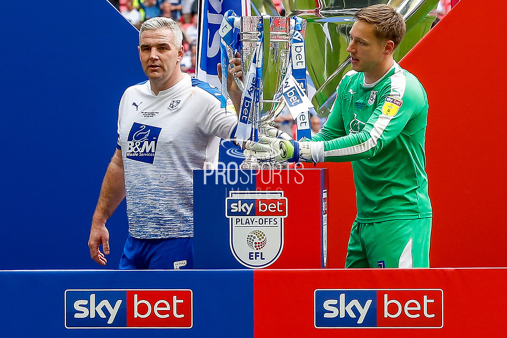 Tranmere Rovers defender Steve McNulty (5) and Tranmere Rovers goalkeeper Scott Davies (1) with the trophy after the EFL Sky Bet League 2 Play Off Final match between Newport County and Tranmere Rovers at Wembley Stadium, London, England on 25 May 2019.