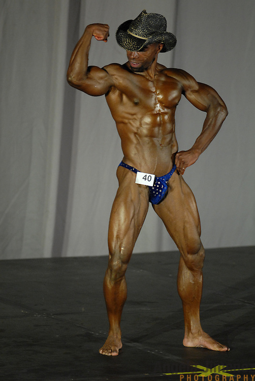 Ron Coleman, of Baltimore, Maryland, poses during the Physique (bodybuilding) competition 40-49 year old age group heavyweight division at McGaw Memorial Hall/Welsh-Ryan Arena at Northwestern University in Evanston, Illinois during the Gay Games VII competition on July 19, 2006. <br /> <br /> Coleman finished first in the standard category in his division. <br /> <br /> Over 12,000 gay and lesbian athletes from 60 countries are in Chicago competing in 30 sports during the Games from July 15 through 22, 2006. <br /> <br /> Over 50,000 athletes have competed in the quadrennial Games since they were founded by Dr. Tom Wadell, a 1968 Olympic decathlete, and a group of friends in San Francisco in 1982, with the goal of using athletics to promote community building and social change. <br /> <br /> The Gay Games resemble the Olympics in structure, but the spirit is one of inclusion, rather than exclusivity. There are no qualifying events or minimum or maximum requirements.<br /> <br /> The Games have been held in Vancouver (1990), New York (1994), Amsterdam (1998), and Sydney (2002).