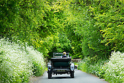 Vintage Bentley 4.5 litres classic car built in 1929 being driven on touring holiday on country lanes in The Cotswolds, England