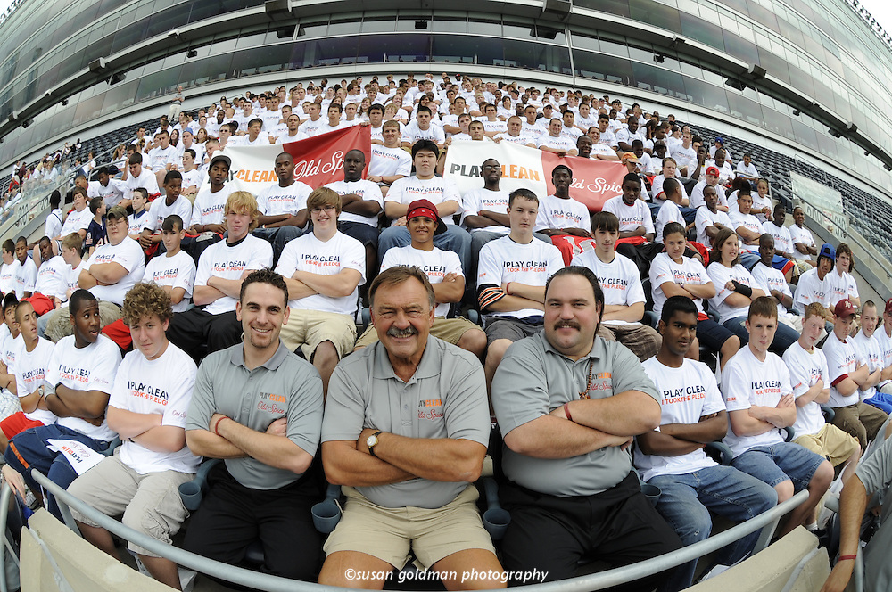 "National Football League Hall of Famer Dick Butkus, center, and over 300 high school athletes strike the official ""I Play Clean"" stance to show solidarity against steroid usage in high school sports, at Soldier Field in Chicago. Old Spice has partnered with the sports legend to inform young athletes about the dangers of steroid use. Photo/Old Spice, Susan Goldman."