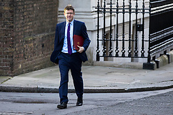 © Licensed to London News Pictures. 18/12/2017. London, UK. Secretary of State for Business, Energy and Industrial Strategy Greg Clark arrives on Downing Street for a special Cabinet meeting in which ministers are expected to discuss the Brexit end deal. Photo credit: Rob Pinney/LNP
