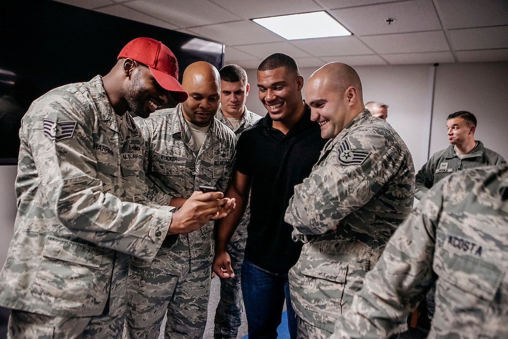 "Prince George's County, MD - December  13, 2016:  WWE star Jason Jordan laughs with members of the US Air Force watching a replay after being tased during Tribute to the Troops Day at the Joint Base Andrews in Prince George's County, Maryland.  ""That was the longest five seconds of my life,"" Jordan said. WWE Superstars will spend time with members of all five branches of the military.  WWE began Tribute to the Troops in 2003 as a way to honor our servicemen and women and their families.   (Greg Kahn for ESPN)"