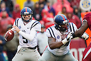 FAYETTEVILLE, AR - NOVEMBER 22:  Ryan Buchanan #9 of the Ole Miss Rebels drops back to pass against the Arkansas Razorbacks at Razorback Stadium on November 22, 2014 in Fayetteville, Arkansas.  The Razorbacks defeated the Rebels 30-0.  (Photo by Wesley Hitt/Getty Images) *** Local Caption *** Ryan Buchanan