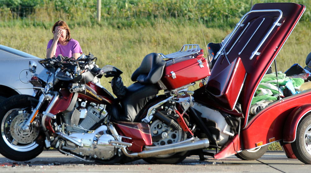 A witness reacts while giving a statement  after witnessing a motorcyclist crash into the back of a semi-truck going east along Interstate 90 near the Hartford, S.D. exit on Fri., Aug.13, 2010. The motorcyclist died on scene.