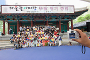 Seoul Nori Madang open-air folcloric theatre. Drummers and dancers from Jindo. Souvenir photo after the performance.