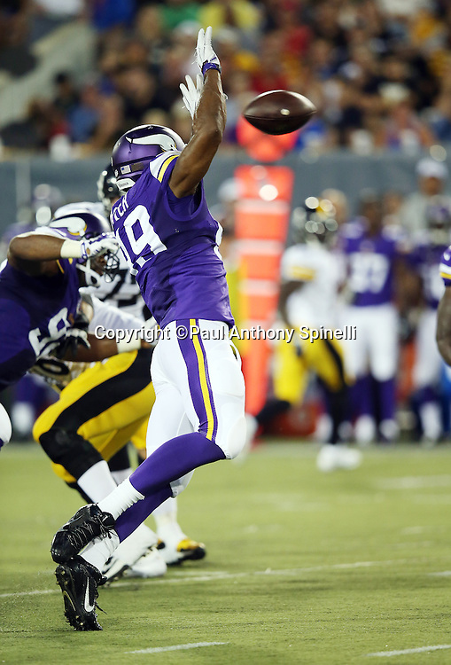 Minnesota Vikings rookie defensive end Danielle Hunter (99) raises his arms as he nearly blocks a pass during the 2015 NFL Pro Football Hall of Fame preseason football game against the Pittsburgh Steelers on Sunday, Aug. 9, 2015 in Canton, Ohio. The Vikings won the game 14-3. (©Paul Anthony Spinelli)
