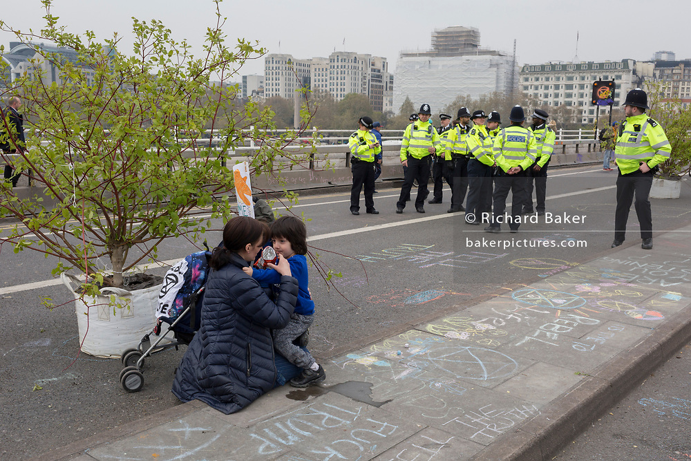 Police officers and Climate Change activists with Extinction Rebellion campaign for a better future for planet Earth after blocking Waterloo Bridge and as part of a multi-location 5-day Easter protest around the capital, on 16th April 2019, in London, England.