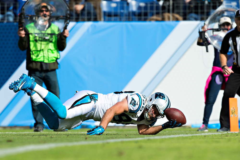 NASHVILLE, TN - NOVEMBER 15:  Greg Olsen #88 of the Carolina Panthers reaches the ball toward the goal line but lands short during a game against the Tennessee Titans at Nissan Stadium on November 15, 2015 in Nashville, Tennessee.  (Photo by Wesley Hitt/Getty Images) *** Local Caption *** Greg Olsen
