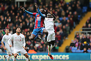 Crystal Palace forward Emmanuel Adebayor  and Liverpool defender Mamadou Sakho (17)  climb for the ball during the Barclays Premier League match between Crystal Palace and Liverpool at Selhurst Park, London, England on 6 March 2016. Photo by Simon Davies.