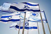 Israeli and Israeli Air force Flags on blue sky background