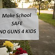 TUESDAY, FEBRUARY 27- 2018---PARKLAND, FLORIDA--<br /> A signed flowers on a sidewalk near Marjory Stoneman Douglas High School expressing anti gun sentiments.<br /> (Photo by Angel Valentin/FREELANCE)