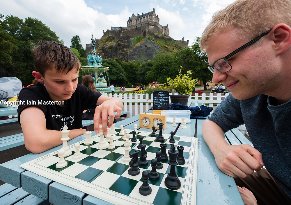Edinburgh, Scotland, UK. 2 August, 2108. Public chess games in cafe in Princes Street Gardens at foot of Edinburgh Castle. James Hartman(L) and Andrew McHarg play chess on tables provided for the public and local chess clubs. They meet every Thursday and Sunday in summer.
