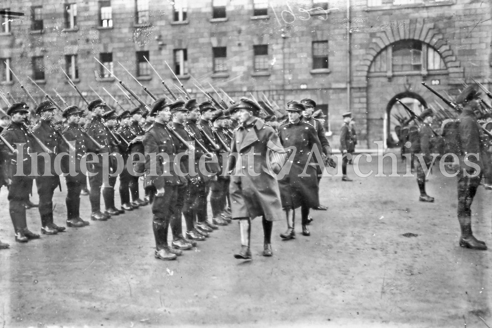 General Richard Mulcahy inspects National Army troops at the Royal (Collins) Barracks, Dublin, after the departure of the British garrison. (Part of the Independent Newspapers Ireland/NLI Collection)