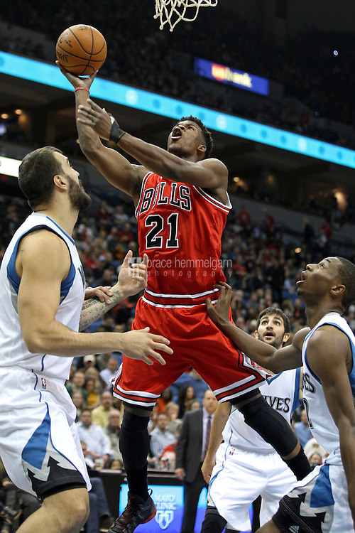 Nov 1, 2014; Minneapolis, MN, USA; Chicago Bulls guard Jimmy Butler (21) shoots during the first quarter against the Minnesota Timberwolves at Target Center. Mandatory Credit: Brace Hemmelgarn-USA TODAY Sports