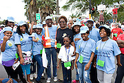 Terre des Hommes Country Programme Coordinator Mafata Mogodi (c) with youth from Gauteng, Limpopo and Durban after the Global Day of Action protest,  , 3 Dec 2011, South Africa.