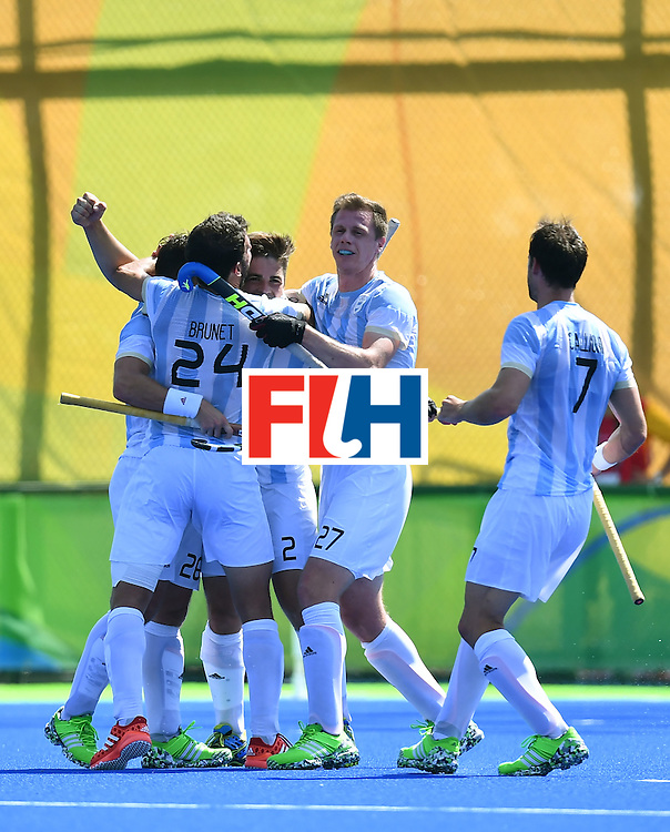 Argentina's Gonzalo Peillat (3rd R) celebrates his third goal with teammates during the men's semifinal field hockey Argentina vs Germany match of the Rio 2016 Olympics Games at the Olympic Hockey Centre in Rio de Janeiro on August 16, 2016. / AFP / MANAN VATSYAYANA        (Photo credit should read MANAN VATSYAYANA/AFP/Getty Images)