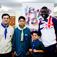 London, UK - 21 July 2012: Team GB Olympic discus thrower Abdul Buhari poses for a picture with volunteers scouts during the Ramadan Iftar 2012 celebrations hosted at the Islamic Cultural Centre (ICC) in Regents Park.