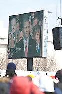 The crowd watches Obama on a Jumbotron at his inauguration.