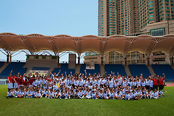 Hong Kong, China - Wednesday, July 25, 2007: Liverpool, Fulham and Portsmouth players pose for a photograph during a coaching session with local children at the Siu Sai Wan Sports Ground in Hong Kong. Players include Sami Hyypia, Jamie Carragher, Andriy Voronin, Yossi Benayoun, Momo Sissoko, Matthew Taylor, David James, Sol Campbell, Liam Rosenior and Hermann Hreidarsson. (Photo by David Rawcliffe/Propaganda)