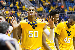 Jan 24, 2017; Morgantown, WV, USA; West Virginia Mountaineers forward Sagaba Konate (50) celebrates after beating the Kansas Jayhawks at WVU Coliseum. Mandatory Credit: Ben Queen-USA TODAY Sports