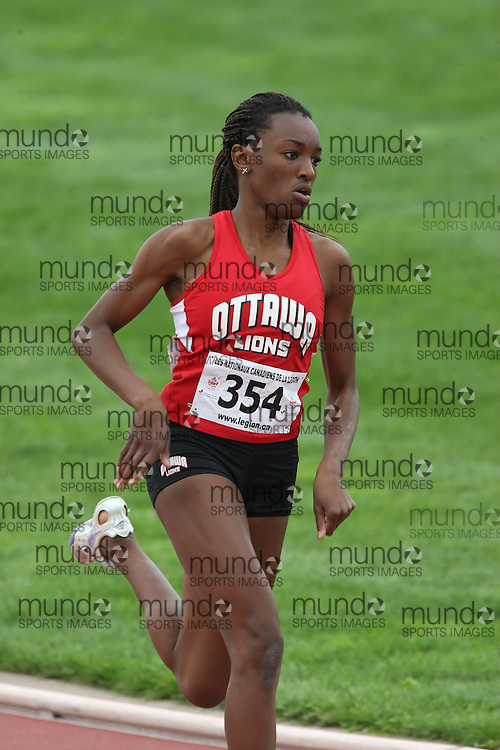 (Sherbrooke, Quebec---10 August 2008) Gift Okankwu competing in the 400m at the 2008 Canadian National Youth and Royal Canadian Legion Track and Field Championships in Sherbrooke, Quebec. The photograph is copyright Sean Burges/Mundo Sport Images, 2008. More information can be found at www.msievents.com.