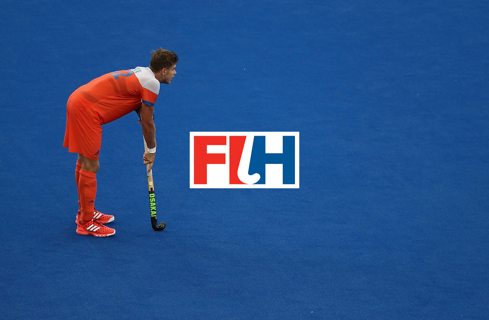 RIO DE JANEIRO, BRAZIL - AUGUST 12:  Sander de Wijn #12 of Netherlands leans on his stick against Germany during a Men's Preliminary Pool B match on Day 7 of the Rio 2016 Olympic Games at the Olympic Hockey Centre on August 12, 2016 in Rio de Janeiro, Brazil.  (Photo by Sean M. Haffey/Getty Images)