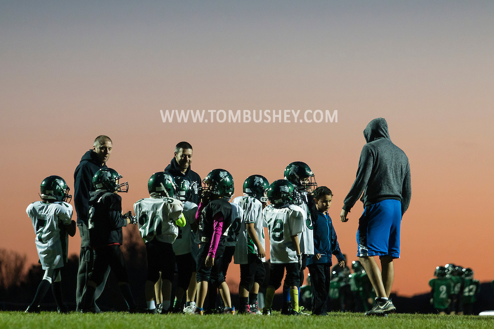 Otisville, New York  - Minisink Valley youth football players practice on the evening of Oct. 22, 2015.