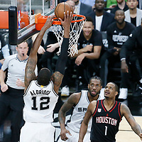 01 May 2017: San Antonio Spurs forward LaMarcus Aldridge (12) goes for the dunk during the Houston Rockets 126-99 victory over the San Antonio Spurs, in game 1 of the Western Conference Semi Finals, at the AT&T Center, San Antonio, Texas, USA.