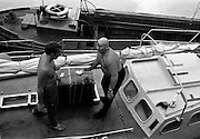 "03/08/1967<br /> 08/03/1967<br /> 03 August 1967<br /> Arrival of ""Saint Brendan II"" in Dublin. Image shows Captain Louis Lourmais (rright) and Vint Lloyd of Nova Scotia, checking equipment and supplies for the ""Saint Brendan II"" a curragh they hoped to sail from Fenit Co. Kerry to America by the Northern Route (Ireland, Iceland, Greenland, North America) and land between Boston and Rhode Island to see if Brendan the Navigator could have reached North America in the 6th century AD. Captain Lourmais had the curragh built to specifications resembling those of what was believed to be the type of craft available in the  6th century. It was the first time the curragh had been in the water since its construction."