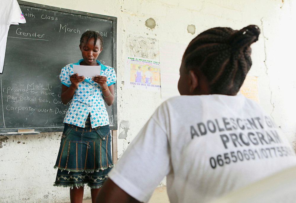 A girl at the Center for Liberian Assistance reads a letter from a U.S. teen as part of the UN Foundation's Girl Up Campaign, Monrovia, Liberia, Sunday, March 6, 2011. She represents one of the millions of adolescent girls around the world whose needs include improved education, access to health and empowerment. (Stuart Ramson for United Nations Foundation)