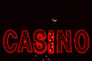Image of a neon casino sign with moon sliver on The Strip in Las Vegas, Nevada, American Southwest