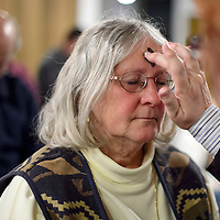 020114       Cayla Nimmo<br /> <br /> Pastor Lorelei Kay imposes ashes on the forehead of  Betsy Windisch during the Ash Wednesday service held at Westminster Presbyterian Church to begin the Christian season of Lent.