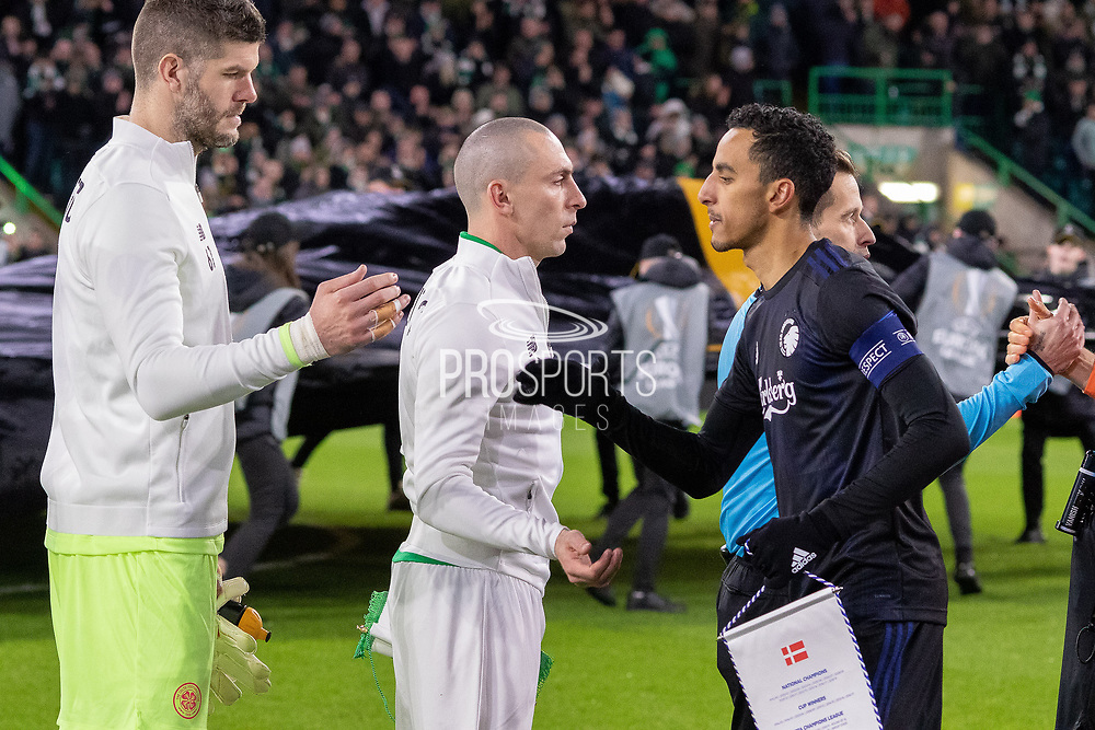 The 2 captains Carlos Zeca of FC Copenhagen & Scott Brown of Celtic FC shake hands ahead of the Europa League match between Celtic and FC Copenhagen at Celtic Park, Glasgow, Scotland on 27 February 2020.
