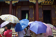 Tourists visiting the Summer Palace in Beijing.